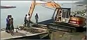 Fail embarcando una excavadora